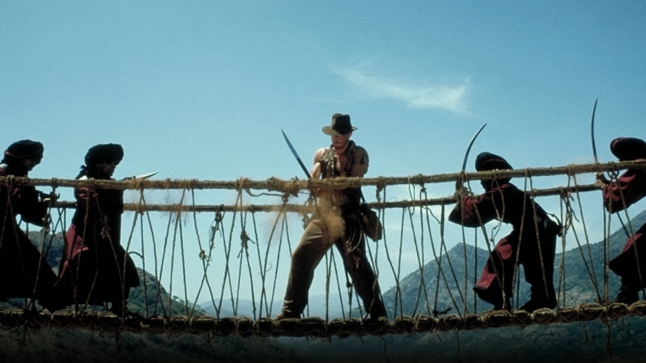 In Temple of Doom, Indiana Jones starts cutting the ropes and holding the bridge up from the enemies.